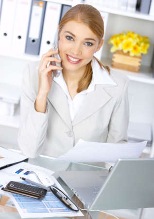 Beautiful business woman working in office, smiling photo