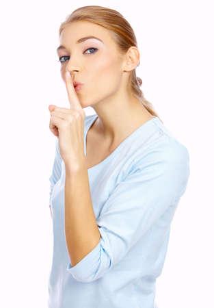 nice looking: Portrait of a nice looking blond woman making quiet gesture