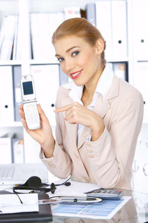 Beautiful business woman showing her mobile phone and smiling Stock Photo - 3952341
