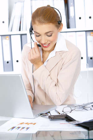 Business woman working in office, wearing headset Stock Photo - 3952318