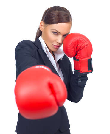 Portrait of beautiful and young business woman wearing boxing gloves