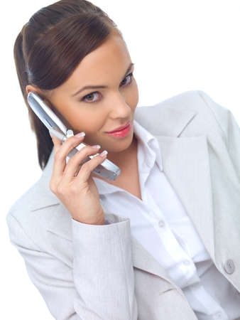 Beautiful business woman talking cell phone and smiling photo