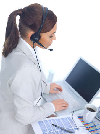 Business woman working in office, wearing headset photo