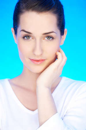 Portrait of 20-25 years old beautiful woman on blue background Stock Photo - 4248732
