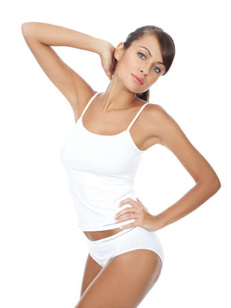 nourish: Young beautiful woman in white fitness clothing