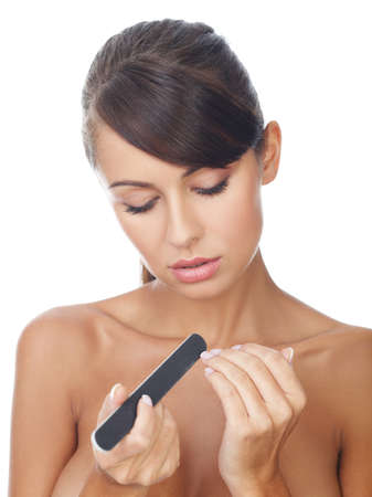 nails model: Portrait of beautiful woman, she is doing her fingernails
