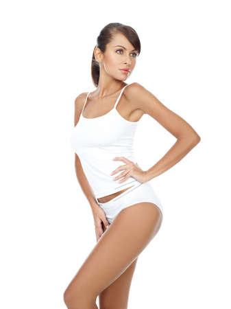 girls underwear: Bella mujer joven en ropa de deporte blanco