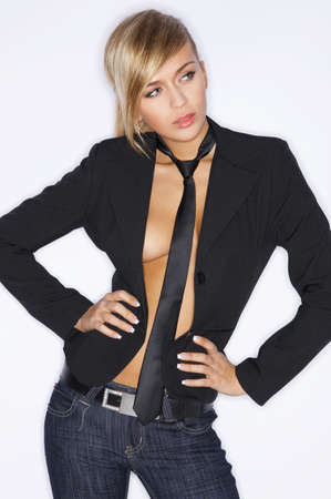 Beautiful sexy woman wearing black suit and tie photo