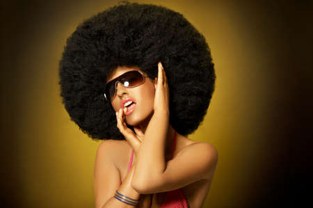 afro woman: Beautiful woman with huge afro haircut on yellow