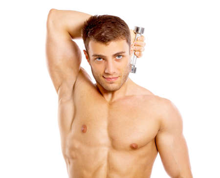 body built: Muscular and tanned male during excersing with dumbbells