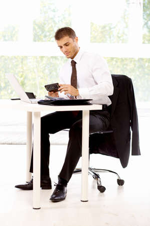 Young business man working in the office photo