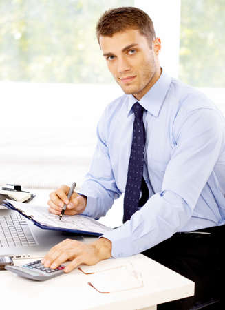 Young business man working in the office Stock Photo - 4752685
