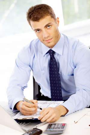 Young business man working in the office Stock Photo - 4752620