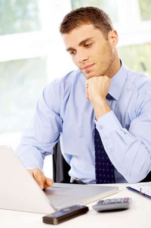 Young business man working in the office Stock Photo - 4752651