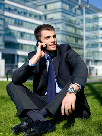 Portrait of business man outside the building photo