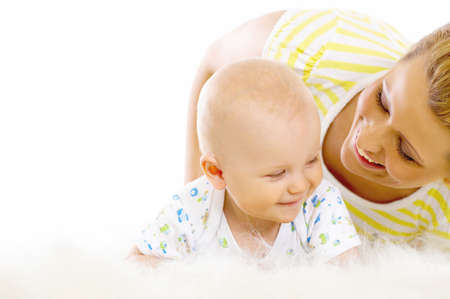 Young attractive mother kissing cute little baby photo