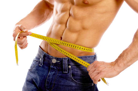 measured: Muscular and tanned male body parts is being measured Stock Photo