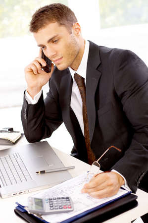 young office workers: Young business man working in the office Stock Photo