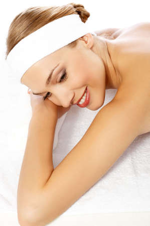 Young beautiful and relaxed lady taking spa treatment photo
