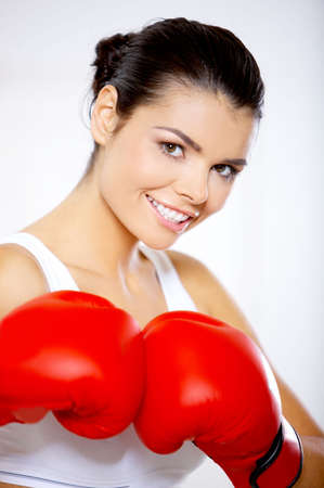 female fighter: Young beautiful woman during fitness time and boxing Stock Photo
