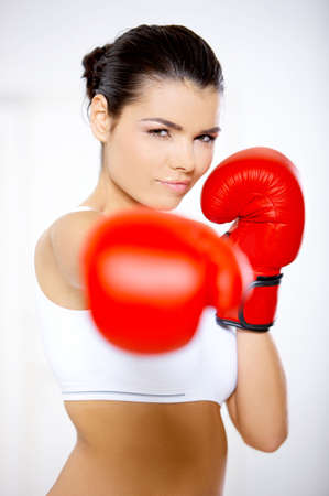 girl punch: Young beautiful woman during fitness time and boxing Stock Photo