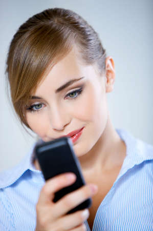 Portrait of beautiful business woman using mobile phone photo
