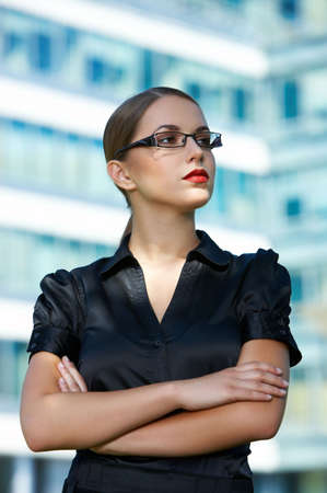Beautiful business woman standing outdoor modern building Stock Photo - 5443438