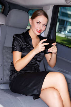 Portrait of beautiful business woman inside the limo car photo