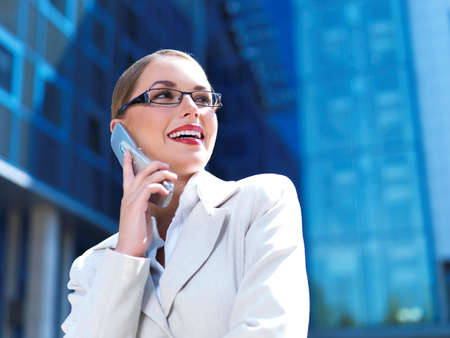 Beautiful business woman on the phone at modern building Stock Photo - 5443458