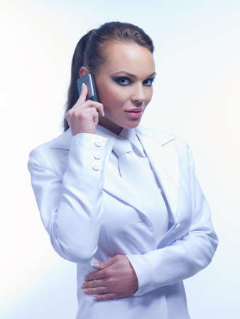 Portrait of Urban Business woman wearing white suit photo