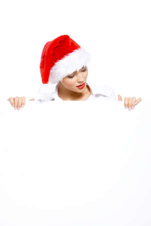 Woman in santa hat with empty white board photo