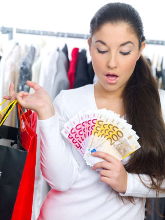 Portrait of a young lady with bags and bunch of money photo