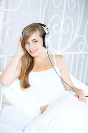 Portrait of cute teenage girl is listening music photo
