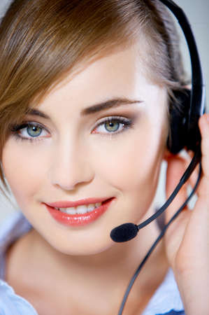 Portrait of beautiful business woman with headset  photo