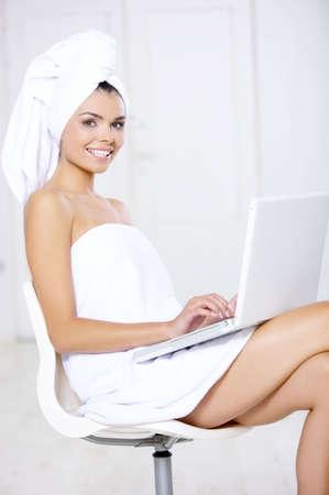 Portrait of beautiful woman working on laptop computer photo