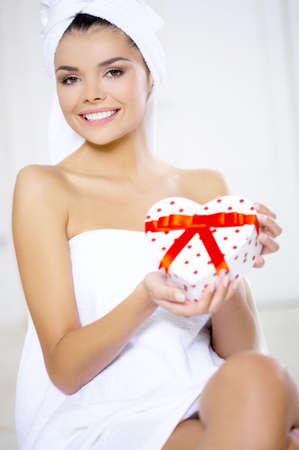 Portrait of beautiful woman with heart shaped box photo