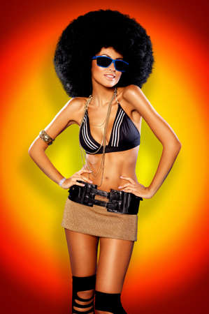 disco girls: Beautiful woman with huge afro haircut color wall Stock Photo