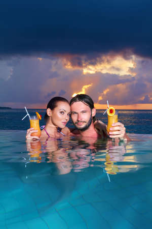 Romantic couple alone in infinity swimming pool Stock Photo - 6878959