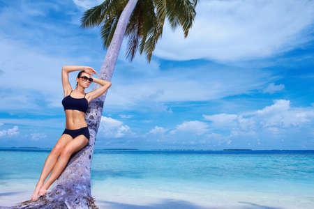 Beautiful woman resting on beach at Maldives