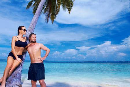Romantic couple resting at Maldives seaside photo