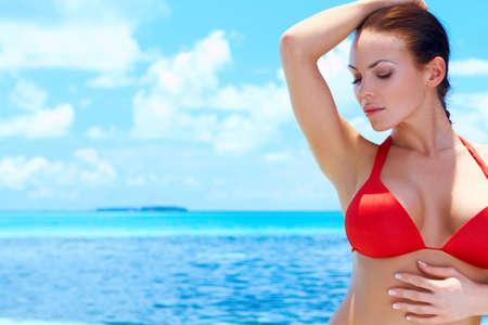 Beautiful woman resting in water at Maldives photo