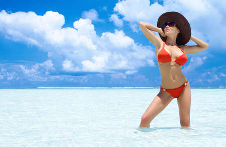 Beautiful woman resting in water at Maldives