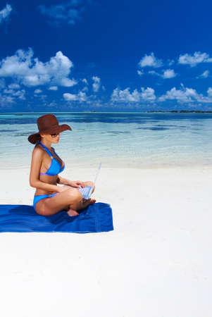 Beautiful woman resting near water at Maldives photo