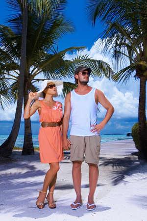 Romantic couple standing next to palm tree photo
