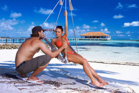 bikini couple: Romantic couple resting at Maldives seaside