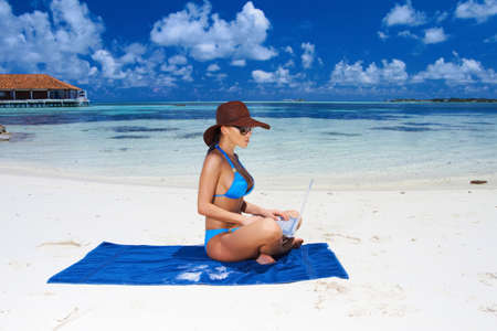 Beautiful woman resting near water at Maldives Stock Photo - 7157812