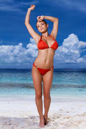 Beautiful woman relaxing on beach at Maldives