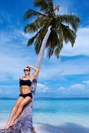 Beautiful woman resting on beach at Maldives photo
