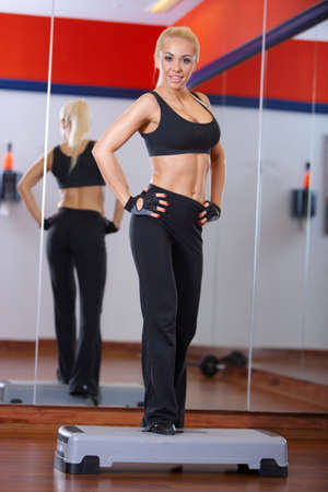 Beautiful woman exercising at the gym Stock Photo - 7315981