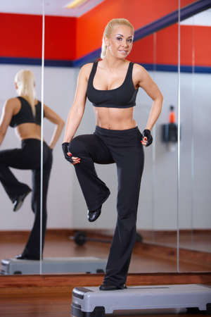 Beautiful woman exercising at the gym Stock Photo - 7315977